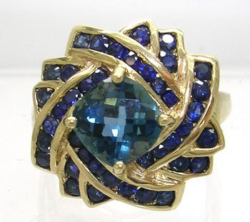 836: 10KY 2ct Blue Topaz .65ct Sapphire Ring