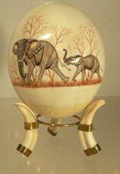 15015: OSTRICH EGG & WARTHOG IVORY TUSK ELEPHANTS M