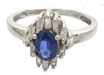 826: 14KW .45ct Sapphire Oval .20ct Diamond Bagg Ring