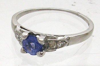 828: 14KW .15ct Tanzanite Diamond RIng