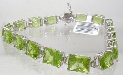 406: 14KW 23ct Chiniese Peridot E-cut Bracelet 10gm