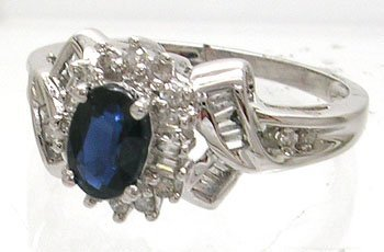 631: 10KW .60ct Blue Oval Sapphire .24cttw Diamond Ring