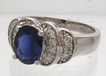 918: 14KW 1.50ct Blue Oval Sapphire .36cttw Diamond Rin