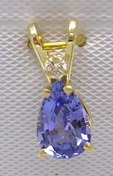 1103: 14KY .75ct Tanzanite pear Diamond Pendant