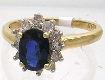 602: 14KY 1ct Sapphire oval .25ct Diamond Ring