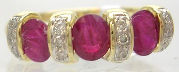 610: 14KY .80ct Ruby Oval .10ct Diamond Ring