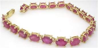1206: 14KY 20ct ruby oval bracelet 7inch