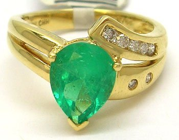 1684: 18KY 2.10ct Pear Emerald .14cttw Diamond Ring