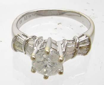 1989: 14KW 1.69cttw Diamond Round Bagguette ring
