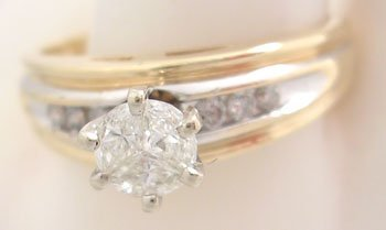 617: 14KY .57ct Diamond Trillion Invisible Set Rd Ring