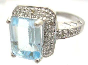 910: 14KW 3.39ct E-cut Aquamarine .09ct Diamond Crown R
