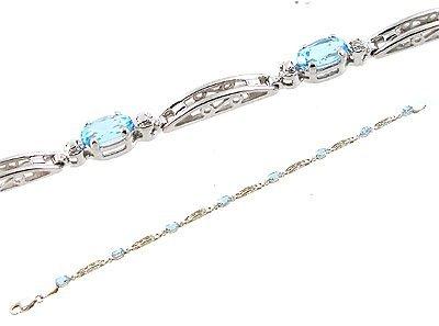 608: 10KWG 2.5ct Blue Topaz oval bar link bracelet
