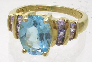 607: 14KY 2.5ct Blue Topaz Oval Tanzanite Channel Ring