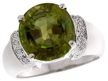 1003: 14KW 6.41ct Green Tourmaline oval dia ring