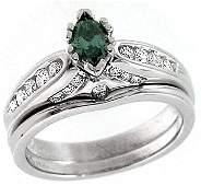 1006: WG .27ct Blue Diamond marquise .41ct Dia ring