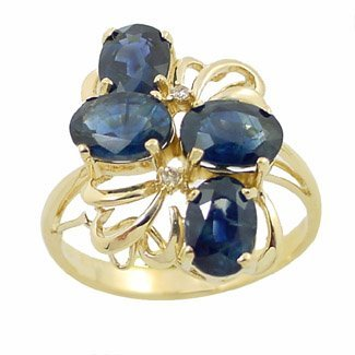 1007: 4ct sapphire 4 oval diamond cluster ring