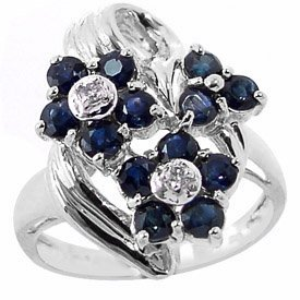 1020: WG 1.75ct blue sapphire 3 flower dia ring