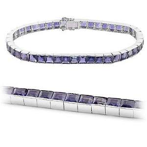 1031: WG 13ct iolite princess cut channel bracelet