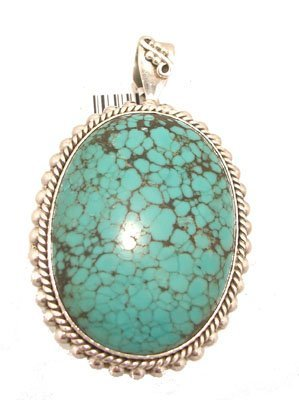 1604: SSilver Oval Spider Web Turquoise Pendant