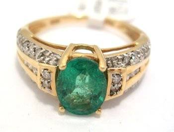 2755: 14KY 1.25ct Columbian emerald oval .20ct diamond