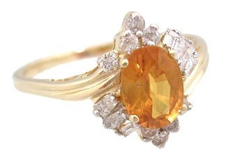 603: 10KY 1ct Orange Sapphire .28Dia bag/rd ring
