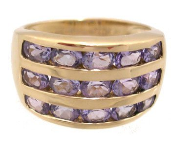 631: 14KY 2ct Tanzanite oval channel band ring
