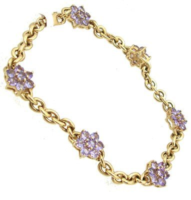 632: 14kt 2.52cttw Tanzanite flower rolo bracelet 7in