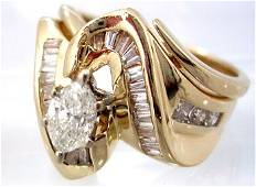 1343: 14KY .85cttw Diamond Marq Bagg Swirl Ring