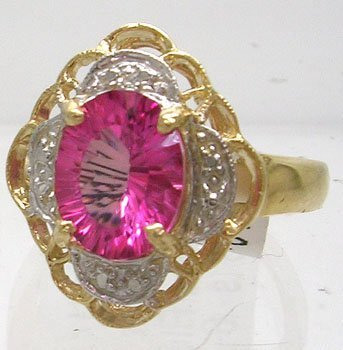 1208: 14KY 2ct Pink Topaz Oval Flower Ring