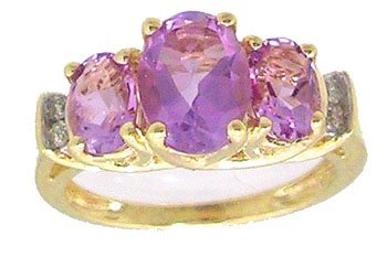 1209: 10KY 2.5ct Amethyst Oval 3 stone Diamond Ring