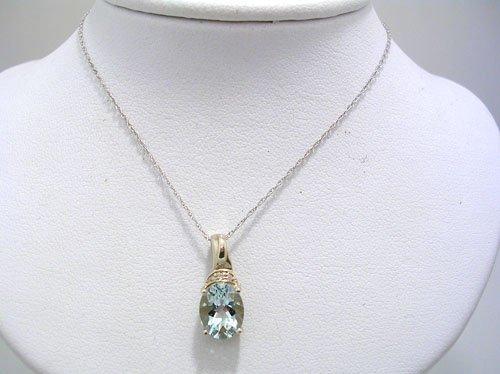 1603: 14KW 2ct Aquamarine oval dia pendant chain