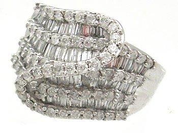 1915: 14KW 1.25cttw Diamond bagguette/rd S wave ring