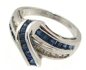 601: 10KW 1cttw Sapphire .11 Diamond channel ring