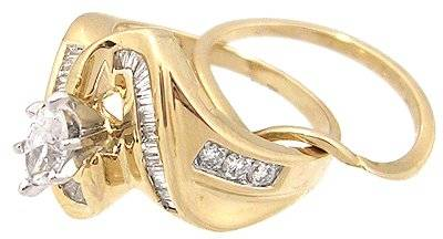 14KY 1ct Diamond Marquise Bagg/Rd channel Ring