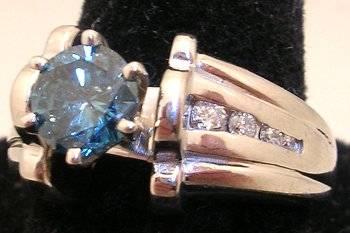 14KW .77ct Blue Diamond Round .14ct Diamond Ring