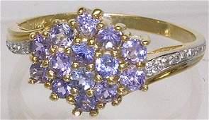 975: 14KYG 1 cttw Tanzanite & Dia Cluster ring