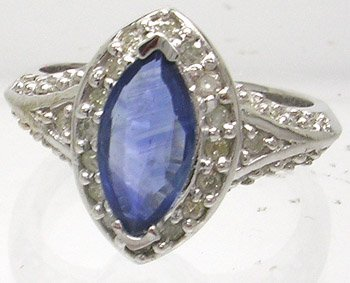 1917: 14kw 2ct Sapphire Marquise .48ct Diamond Ring
