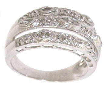 1921: 18WG .37cttw marq/rd Diamond designer band ring