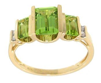 1206: 14KY .75ct Peridot 3 emerald cut Diamond ring