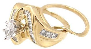 1289: 14KY 1ct Diamond Marquise Bagg/Rd channel Ring