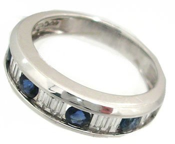 1630: 14KW .50ct Sapphire .50ct Dia channel band Ring