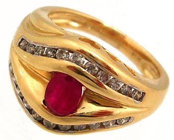 901: 14KY .50ct Ruby oval .25ctw Dia channel band ring