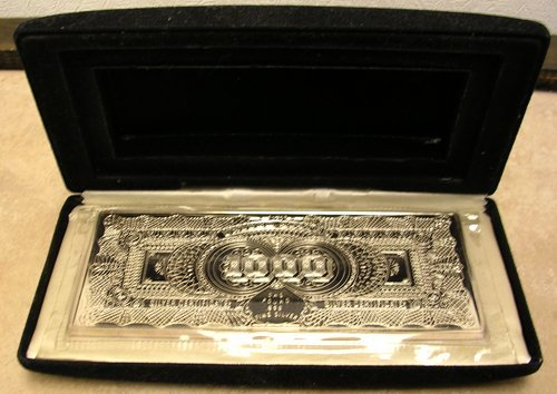 8219A:  999 Silver 1000 dollar bill cast 487grams