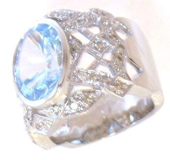 821: 14KW 6.09ct Blue Topaz Oval .37ct Diamond Ring