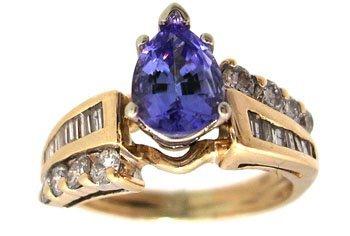 3114: 14KY.88 Tanzanite Pear .30ct Diamond Rd Bagg Ring