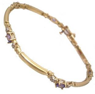 10KY .50cttw Tanzanite 5 oval .05Dia bar bracelet