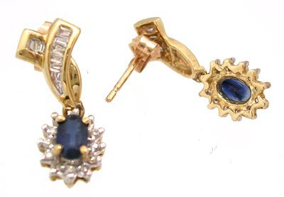 829: 10KY .50ct Sapphire oval .23 dia bagg earring
