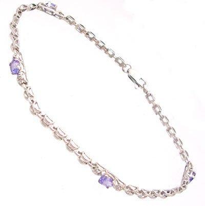 832: 10KW .40cttw Tanzanite oval dia link bracelet