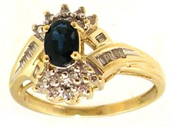 1110: 10KY .63ct Sapphire Oval .20cttw Diamond Ring