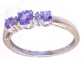 1303: 14KW .42ct Tanzanite Rd Diamond 3 Stone Ring